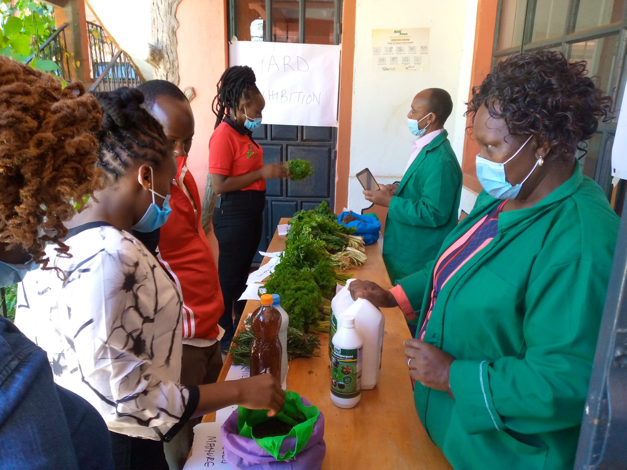 OACK Farmer showcasing her products during the 2020 World Soil Day Celebrations