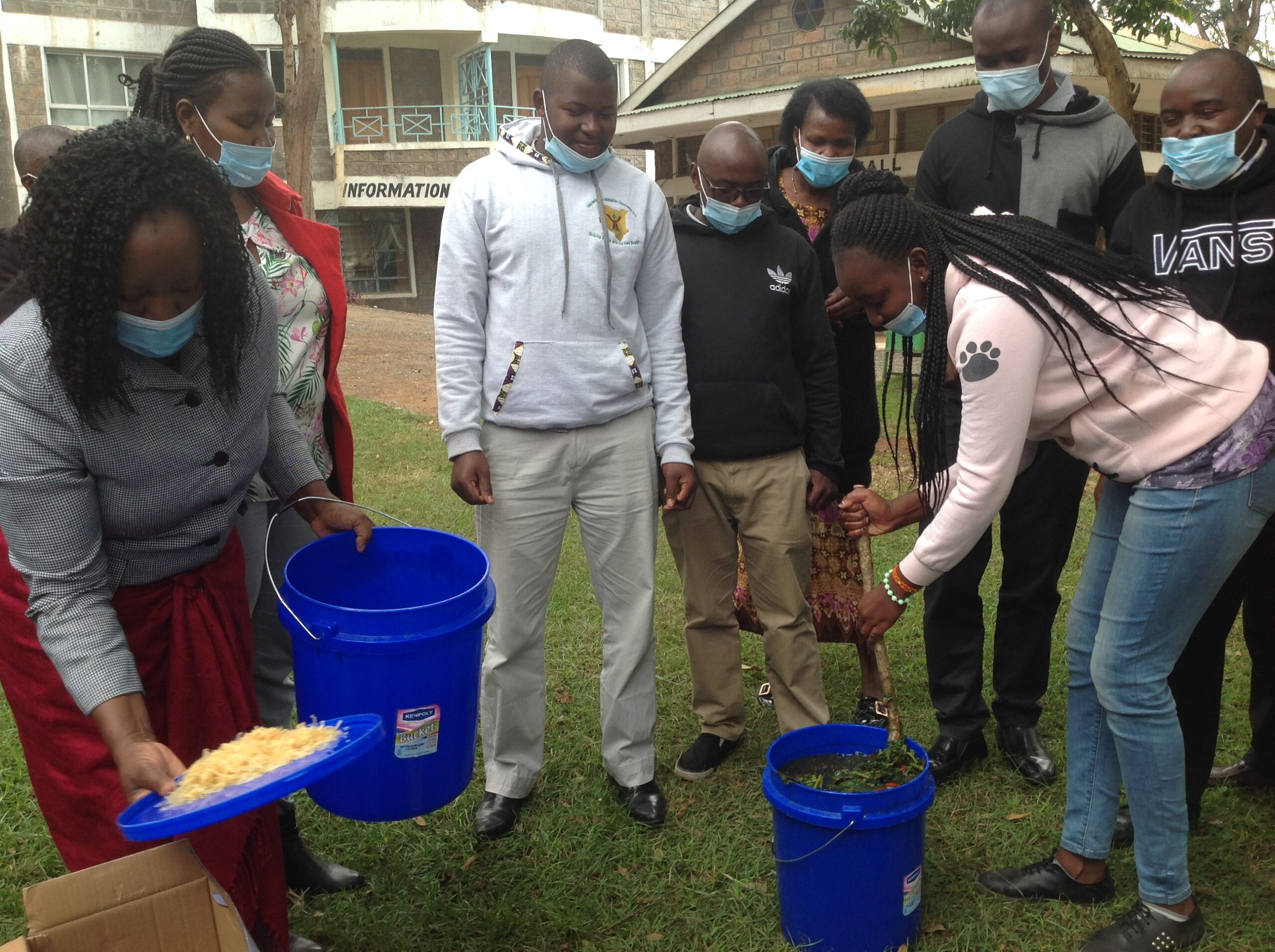 Participants of IPM workshop conducting a practical training on making botanical pesticides